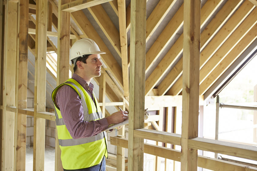 A Builder Looking at Home Framing.