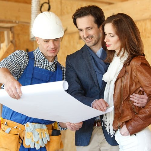 A Custom Home Builder Talking to a Man and a Woman.